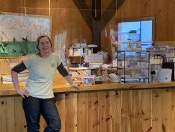 April Lemay in front of her cafe desk